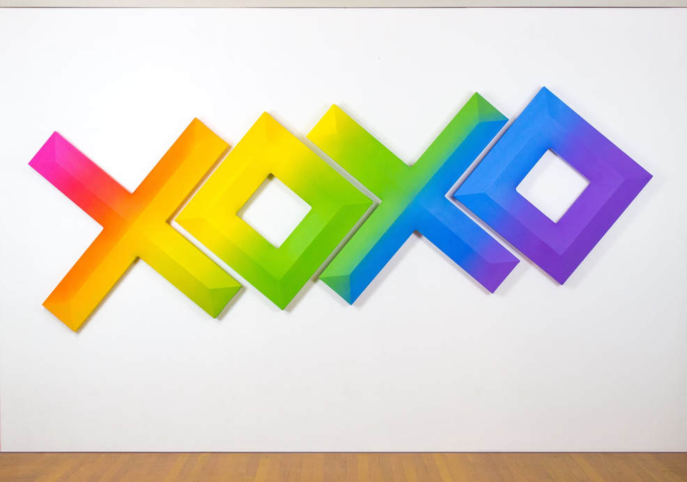 tim kent art xoxo shaped canvas painting with rainbow gradient